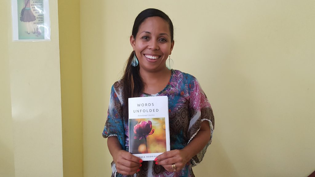 Andrea Rodriguez with her copy of Words Unfolded